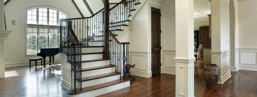 Updated staircase with dark hardwoods and iron spindles
